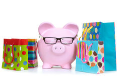 Money-box and multicolored bags Royalty Free Stock Images