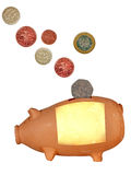 Money box piggy bank with uk coins,isolated Royalty Free Stock Photo
