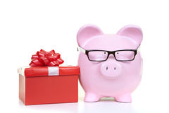 Money-box and red fancy box Stock Photography