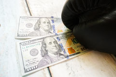 Money with boxing gloves. On wooden background Stock Photography