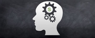 Money on the Brain. A head sketched on a blackboard with gears turning inside the brain and a dollar symbol shown Royalty Free Stock Images