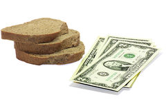 The money for the bread. Two dollars and bread to symbolize donations Stock Photography