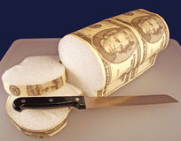Money Bread. Some slices of bread from a twenty dollar bill loaf royalty free stock photos