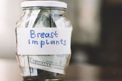 Money for breast implants . Royalty Free Stock Photos
