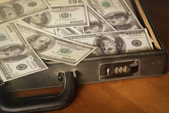 Money in briefcase,vintage style color. Royalty Free Stock Photos
