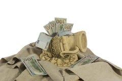 Money in the broken jug royalty free stock photo