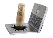 Money and broken laptop Royalty Free Stock Photos