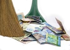 Money and broom. Money dollars and tenge and broom Royalty Free Stock Photography