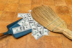 Money and broom. Business concept Royalty Free Stock Photography