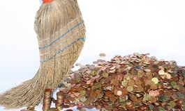 The money broom, clean sweep. Brooming money isolated Stock Image