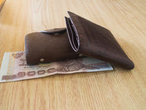 Money in a brown wallet Stock Image
