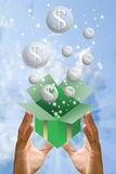 Money bubble flying from gift box with sky Stock Photo