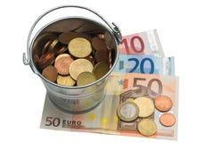 Money in bucket Stock Photography