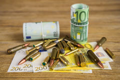 Money and bullets2 Royalty Free Stock Photos