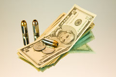 Money and bullets Royalty Free Stock Photo