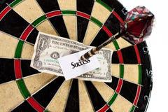 Money and bullseye Royalty Free Stock Photos