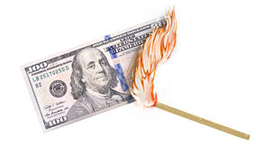 Money Burn. A banknote being burned by a match with burning in a big flame Stock Photography