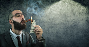 Money burning - businessman arrogant Stock Image