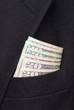 Money in a business suit pocket Royalty Free Stock Images