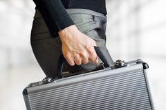 Business woman holding an aluminium briefcase Royalty Free Stock Images
