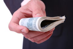 Money in a businessman hands Stock Photography