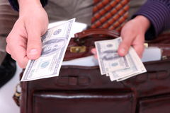 Money in a businessman hands Royalty Free Stock Image