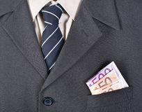 Money in the businessman pocket Royalty Free Stock Images