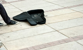 Money in buskers guitar case Royalty Free Stock Photos
