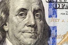 Money, busyness and finances concept. One hundred dollar bill detail with president Franklin portrait close-up. American national. Currency banknote. Symbol of royalty free stock photography