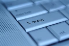 Money Button. Close up of a money key or button on a keyboard Royalty Free Stock Photos