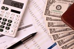 Money, calc and Graph Stock Photos