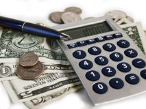 Money Calculation. Money, calculator, pen and coins on white Royalty Free Stock Photos