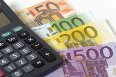 Money and calculator. Calculator and various paper money euro banknotes Stock Photography