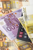 Money and calculator. Lot of paper money euro banknotes and calculator Royalty Free Stock Photos