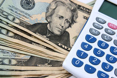 Money and calculator Stock Images