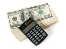 Money and calculator. Stack of dollars and calculator on white background (isolated Royalty Free Stock Image