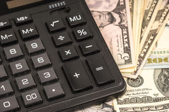 Money and calculator Royalty Free Stock Images