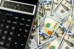 Money and calculator Stock Photos