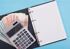 Money, calculator and blank notepad Royalty Free Stock Photos