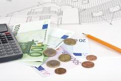 Money and calculator on a blueprint