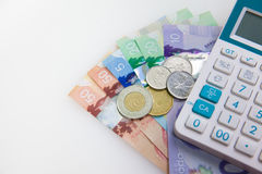 Money and calculator for Budgeting Stock Photo