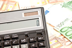 Money and calculator Stock Image