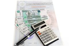 Money, calculator, certificate, a pen. On a white background Stock Image