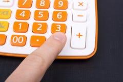 Money and calculator Stock Photo
