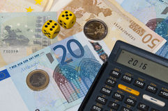 Money and calculator and dice in year 2016 Stock Images