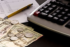 Money, calculator and financial statement. Selective focus on paper currency with adding machine, financial statement and yellow pencil Royalty Free Stock Image