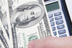 Money with calculator and finger Royalty Free Stock Images
