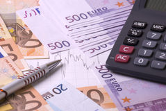 Money, calculator, graph and pen Royalty Free Stock Photo