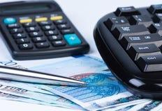 Money, calculator and keyboard. Euro money calculator, keyboard and ball pen close up royalty free illustration