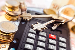 Money, calculator and keys. Royalty Free Stock Images